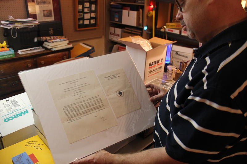 Steven Brawley of the St. Louis LGBT History Project holds a 1974 same-sex wedding invitation.