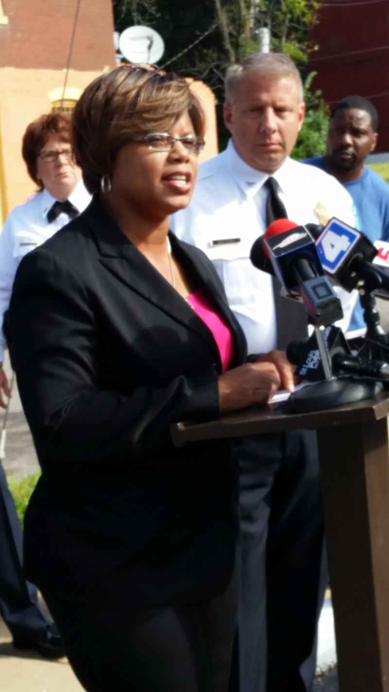 St. Louis Metropolitan Police chief Sam Dotson listens as state Sen. Jamilah Nasheed announces her plans to introduce legislation mandating 10 years in prison for gun crimes in Missouri.