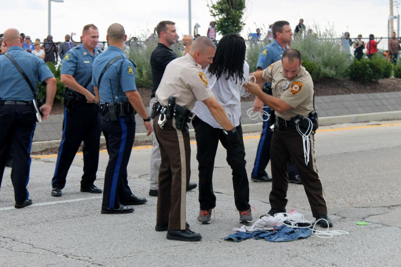 Police arrest protester in the middle of Hanley Road near Interstate 70 on September 10, 2014.