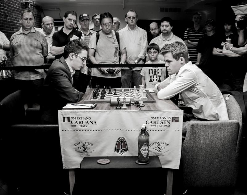 Fabiano Caruana, left, defeated the inaugural cupholder Magnus Carlsen in the first round of the 2014 Sinquefield Cup.