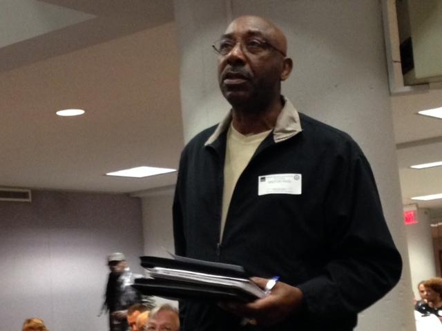 Vietnam veteran, Chester Chunn, stands to speak at a veteran's town hall meeting in downtown St. Louis.