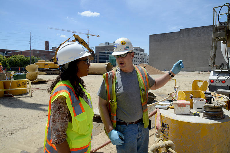 Engineer Ramona Tumblin-Rucker speaks with construction worker Richard Schafer at the job site of a BJC HealthCare garage.