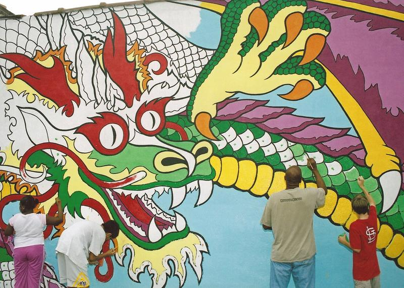 Dragon mural in progress in the Grove