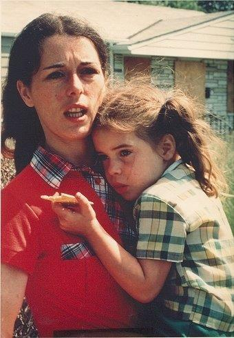 Lois Gibbs holds her daughter Missy stands outside her Love Canal home in Niagara Falls, N.Y., in 1978.