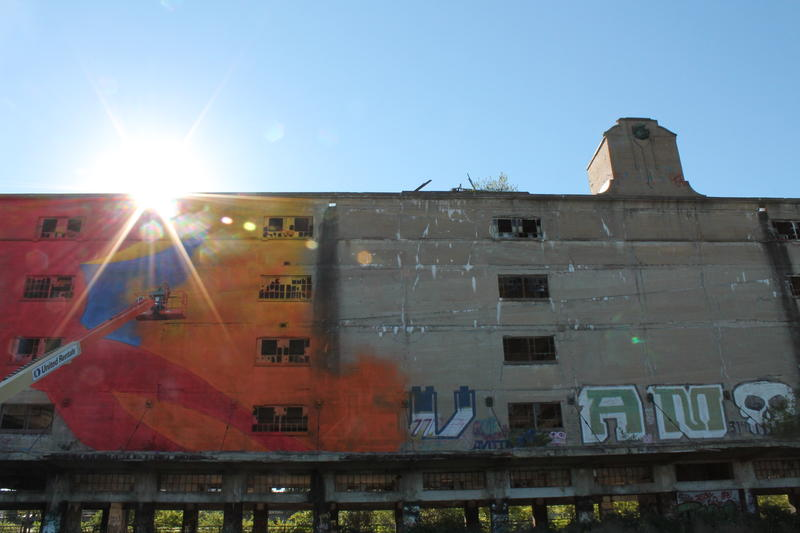 The mural takes shape on the Cotton Belt building.