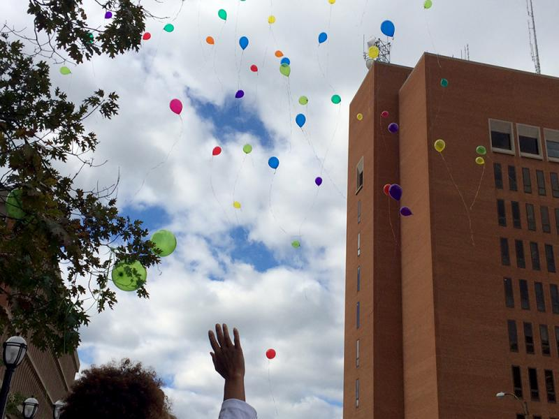 Balloons are released into the sky at the end of the Mother's March on October 18, 2014 in Clayton. The march is call to end all violence and represents the 110 homicides reported so far in 2014 in the city of St. Louis.