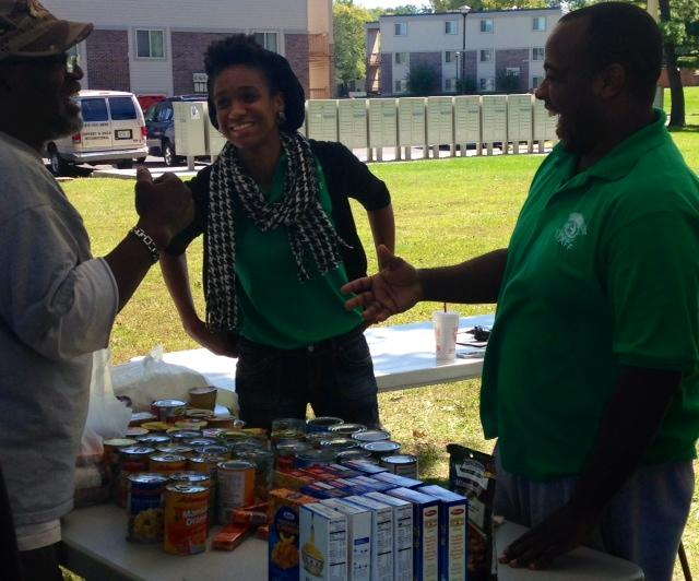 Samantha Madison (center) and William Hardrick (right) of Better Family Life help staff a bi-weekly food pantry at Canfield Green.
