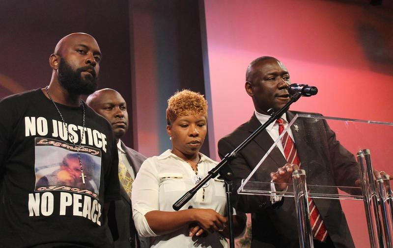 Michael Brown's parents, Michael Brown, Sr. (far left) and Lesley McSpadden (center), have sent a letter to Gov. Nixon asking him to appoint a special prosecutor in the grand jury investigation into their son's death.