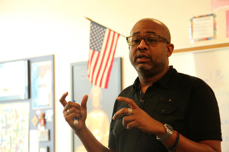 Vincent Flewellen leads a lesson on Ferguson during his eighth-grade multicultural studies course at Ladue Middle School.