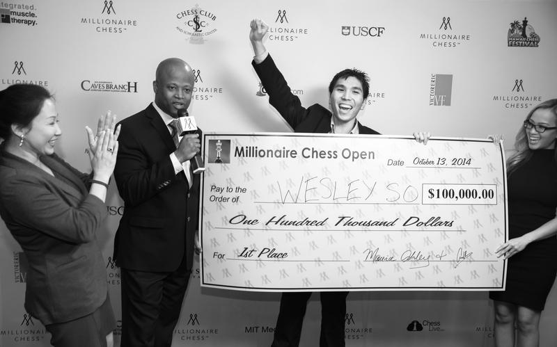 Millionaire Chess Open organizers Amy Lee and GM Maurice Ashley award Webster University GM Wesley So with a $100,000 birthday present.