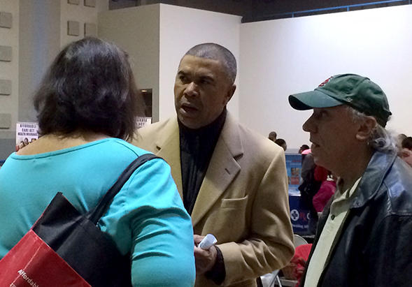 U.S. Rep. Lacy Clay speaks with Rhonda and John Kiely at the health insurance resource fair at the St. Ann Community Center on Saturday, November 15, 2014.