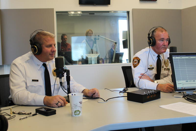 "St.Louis Police Chief Sam Dotson, left, and St. Louis County Police Chief Jon Belmar prepare for an interview on ""St. Louis on the Air"" at St. Louis Public Radio on Nov. 14, 2014."