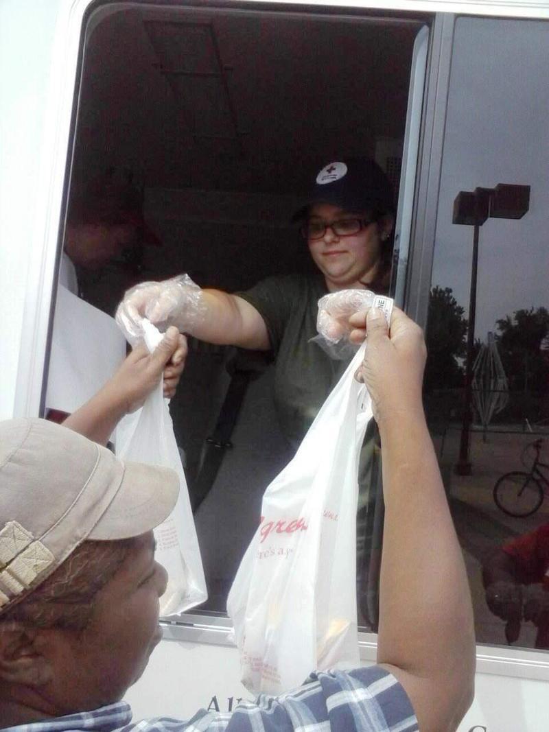 A Red Cross volunteer distributes food in Ferguson in August.