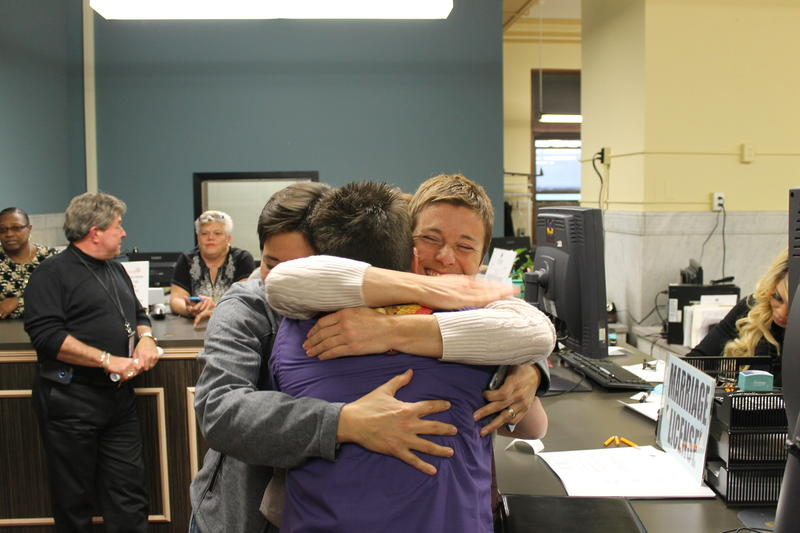 A group of women hug at the St. Louis Recorder of Deeds office after a judge struck down Missouri's ban on same sex marriage.