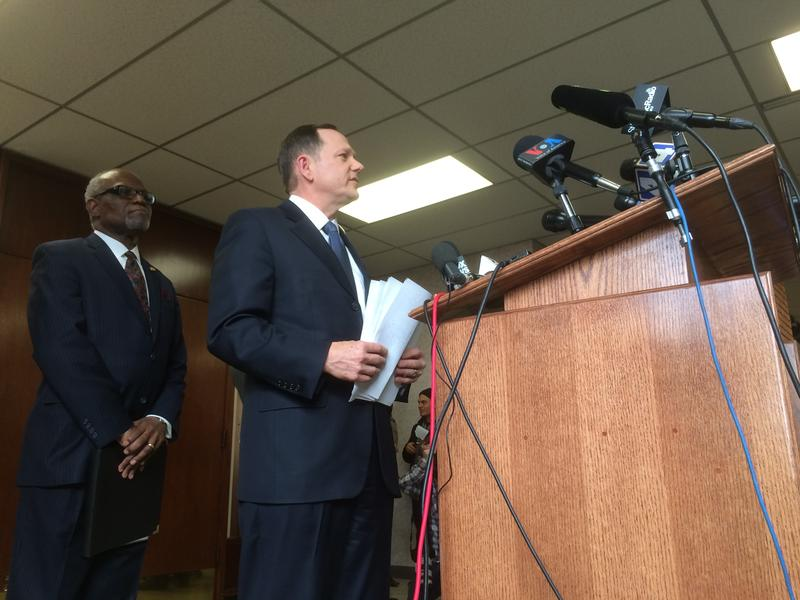 St. Louis Mayor Francis Slay (right) and St. Louis County Executive Charlie Dooley (left) meet the press on Friday. Slay told reporters that police and protesters are talking in advance of a grand jury decision regarding Ferguson Police officer Darren Wil