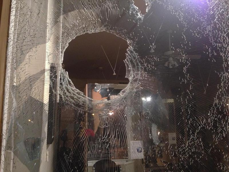 Many businesses along South Grand Boulevard suffered glass damage. Nov. 24