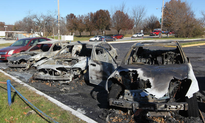 Shells of used cars are all that remain after they were destroyed by fire during a night of turmoil in Ferguson Nov. 25.