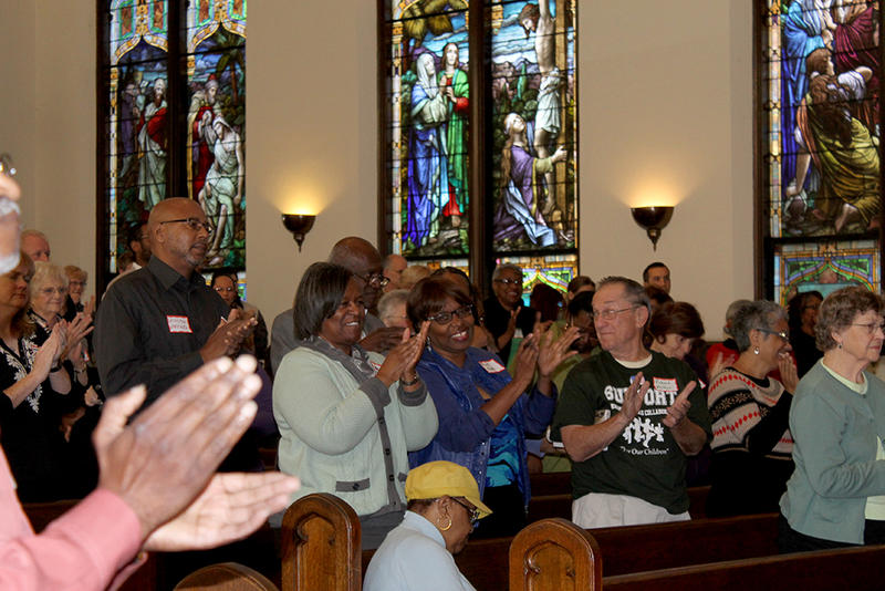 Education summit-goers applaud keynote speaker John Jackson of Schott Foundation for Public Education Saturday Nov. 1, 2014 at St. John's UCC.