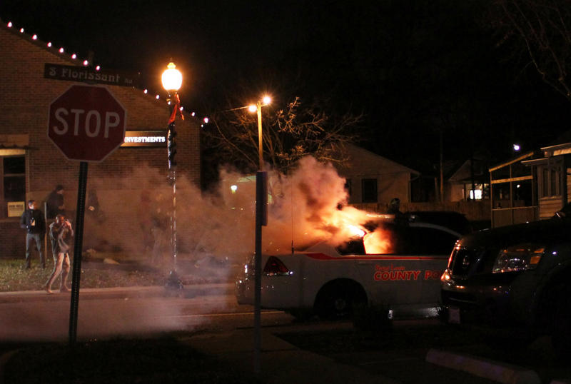 One of two county police cars that were burned Monday night in Ferguson 11/24