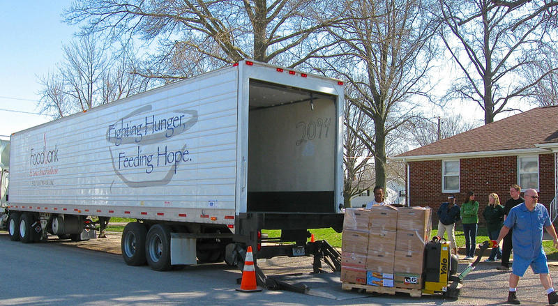 A truck from the St. Louis Area Food Bank makes a delivery at a rural southern Illinois church that was holding a food fair for low-income residents.