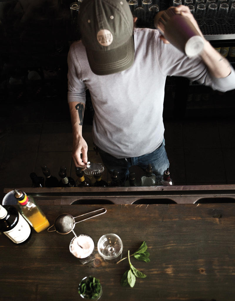 Bar manager Joel Clark mixes drinks at The Purple Martin in St. Louis.
