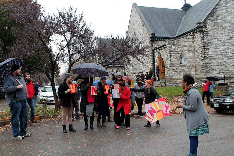 """Before the unity walk in Shaw, participants had to work together to put the word """"unity"""" in order."""