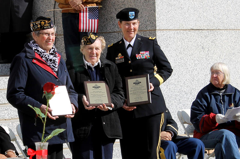 Parade grand marshalls Velma Jesse, Army WAC, Alice Anderson, Navy WAVES, and Major General Susan Davidson, commander of SDDC at Scott Air Force Base.