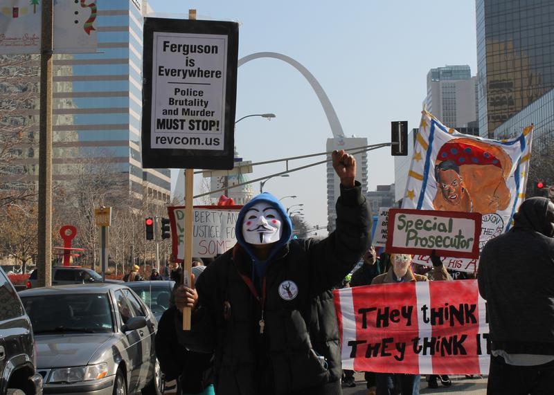 Demonstrators lead chants including