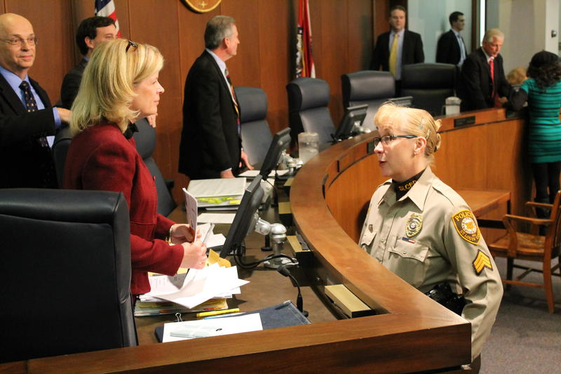 Councilwoman Colleen Wasinger speaks with a member of the St. Louis County Police Department on Tuesday. The council approved transferring money from the county emergency fund to pay for police overtime accrued during the Ferguson unrest.