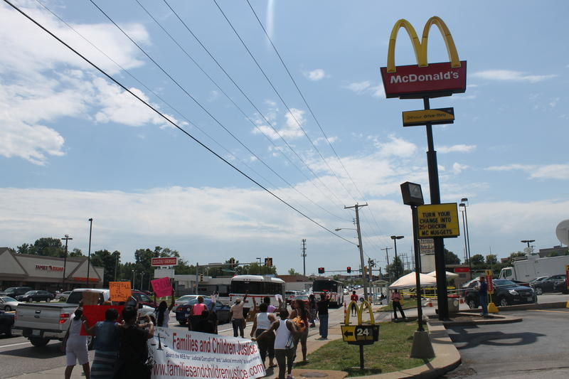 Protesters march down West Florissant Avenue in Ferguson earlier this year.