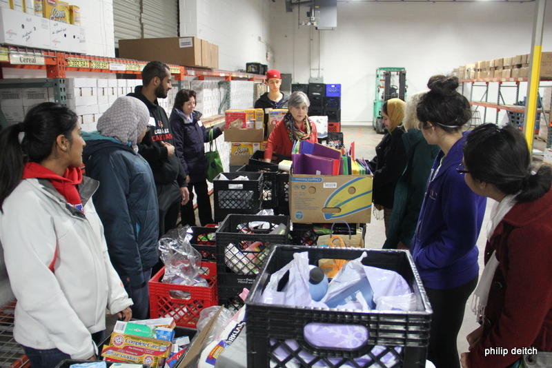 Members of a Jewish and Muslim Teen Dialogue Group packed bags at the Harvey Kornblum Jewish Food Pantry last year.
