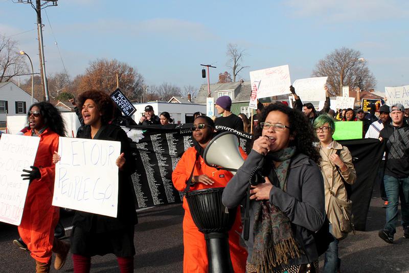 Protest organizer Juliette Iacovino shouts into a bullhorn.