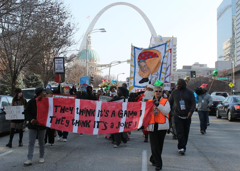 "The ""Carnival of Injustice"" marched through downtown St. Louis."