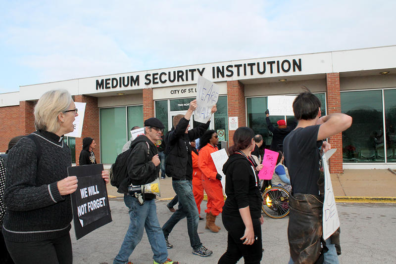 Protesters approach the Hall Street jail.