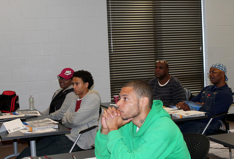Five of the original 12 participants in the first session of BUD listen intently to their instructor on the first day of training October 6, 2014.