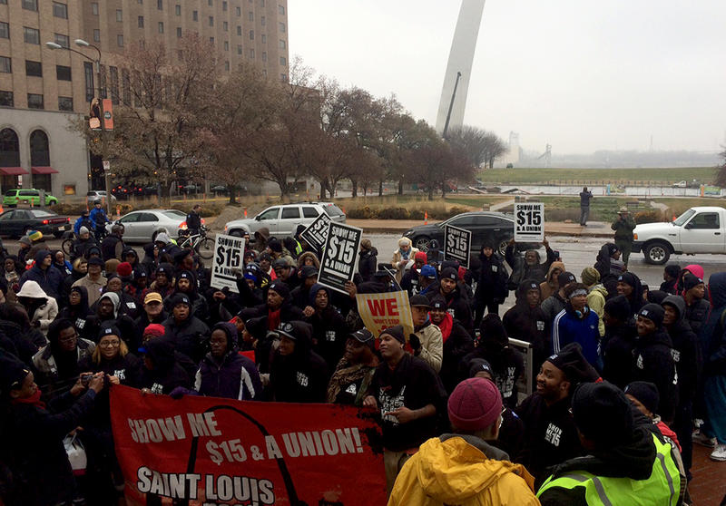 Fast food workers and their supporters pause in front of the Gateway Arch during a march for $15 an hour on Thursday, December 4, 2014.