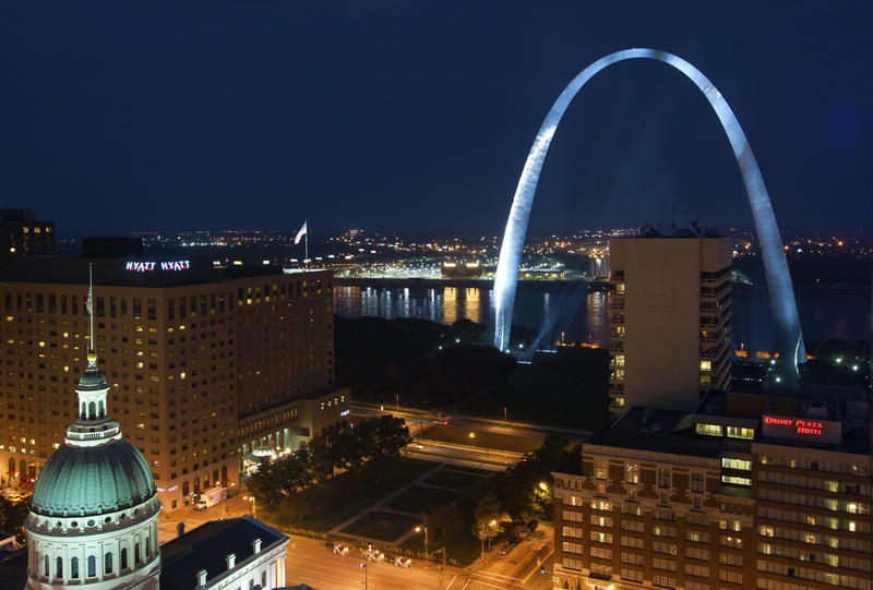 The Gateway Arch is illuminated from the rooftop of the Hilton Inn at the Ballpark in St. Louis.