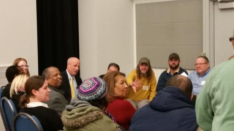 Chuck Wexler (in yellow tie), the executive director of the Police Executive Research Forum, leads a small group discussion on policing in St. Louis on January 7, 2015.