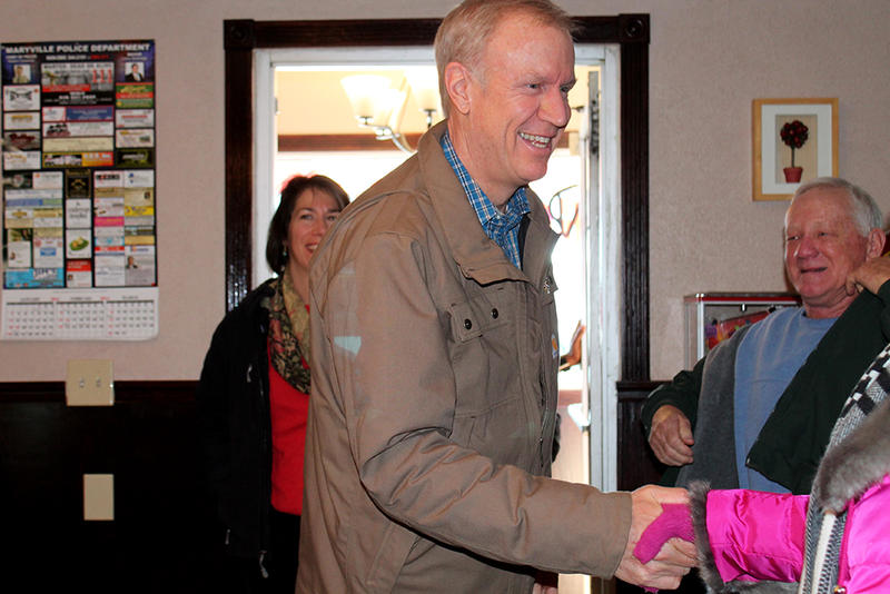 Illinois Gov.-Elect Bruce Rauner shakes the hand of a diner at Red Apple Family Restaurant in Maryville, Ill. on January 10, 2015.
