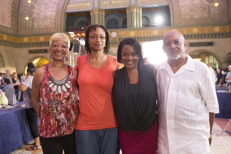 Evelynn Johnson, second from left, and her family meet with genealogist Kenyatta Berry, second from right, at Union Station in St. Louis during filming for PBS' 'Genealogy Roadshow.' Johnson's story will be shared in the show's Feb. 10, 2015, episode.
