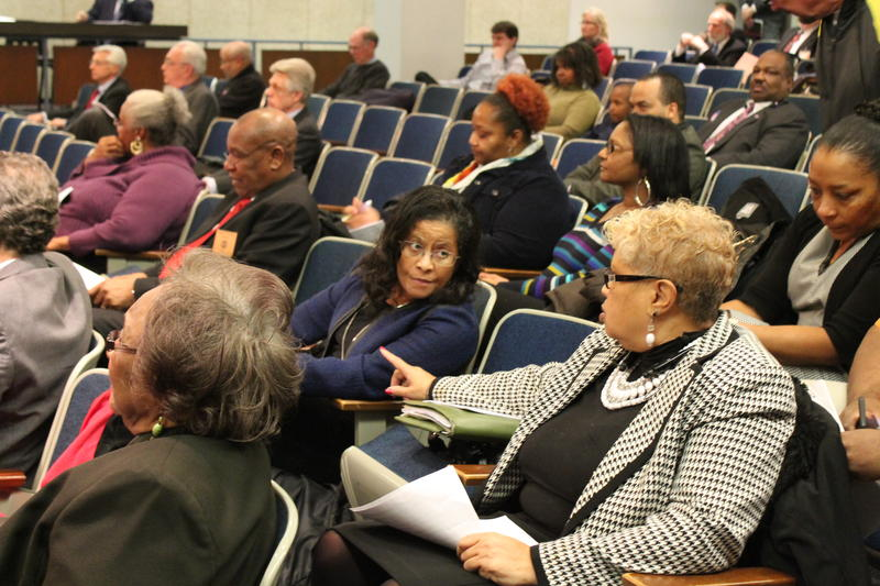 Greendale Mayor Monica Huddleston, center, and Cool Valley Mayor Viola Murphy, right, converse during last Tuesday's St. Louis County Council meeting. Murphy and Huddleston have pushed back against the movement to disincorporate St. Louis County towns --