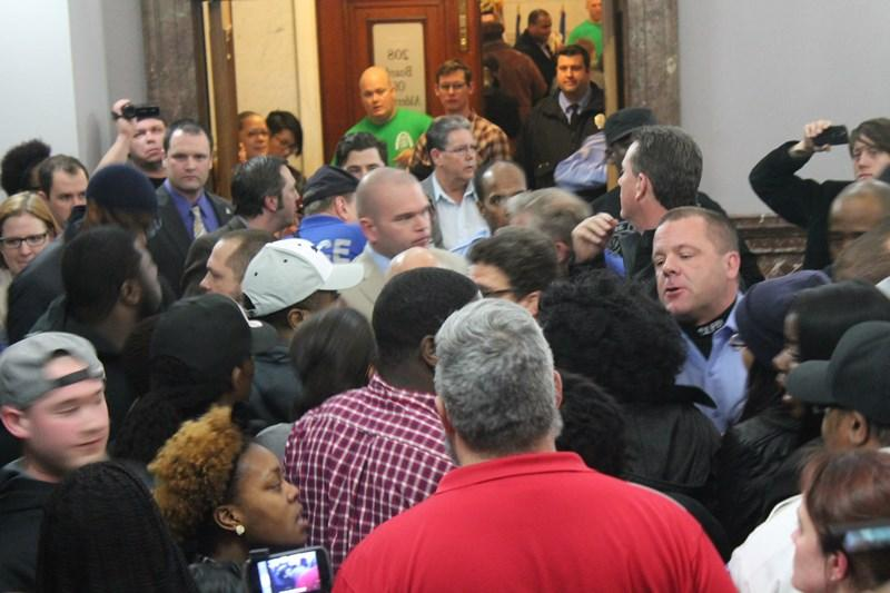 Police and protesters scuffle after police union business manager Jeff Roorda allegedly grabbed a protester at a January 28 meeting oh the public safety committee.