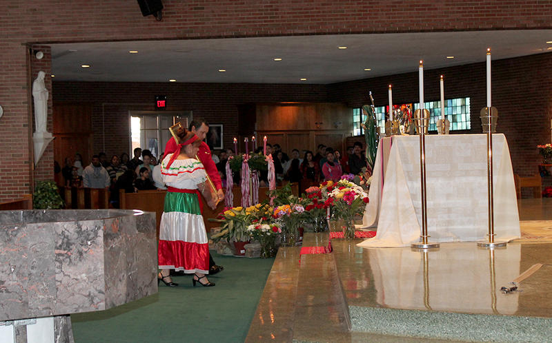 Jesus Montoya and Guilermina Llamas place the icon of the patron saint of Mexico in a place of honor inside Holy Trinity Catholic Parish.