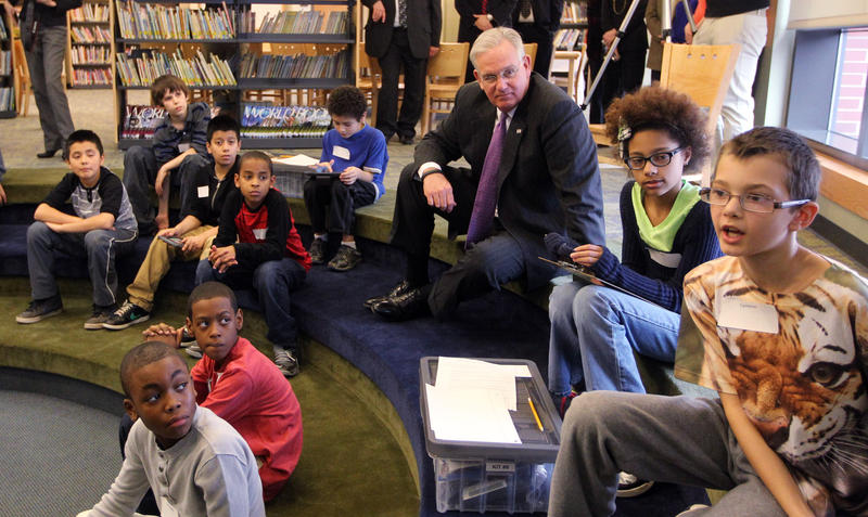 "Missouri Governor Jay Nixon sits with school children from Marion Elementary School as they discuss the school's ""Lead the Way,"" program in Overland, Missouri on January 22, 2015. Lead the Way is a project-based program that provides hands-on learning exp"