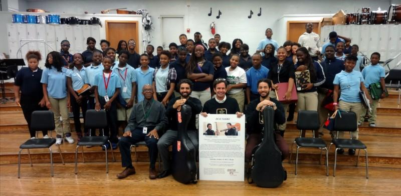 Guitar duo Noire, guitarists Thomas Flippin and Chris Mallett, visited Normandy Middle School in 2014. Normandy Middle School and Normandy High School have guitar programs; instruments and supplies were provided by the St. Louis Guitar Society and Beyond