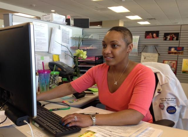 Stem cell transplant recipient Samantha Carter, 30, works at her desk in the Center for Outpatient Health at Barnes-Jewish Hospital.