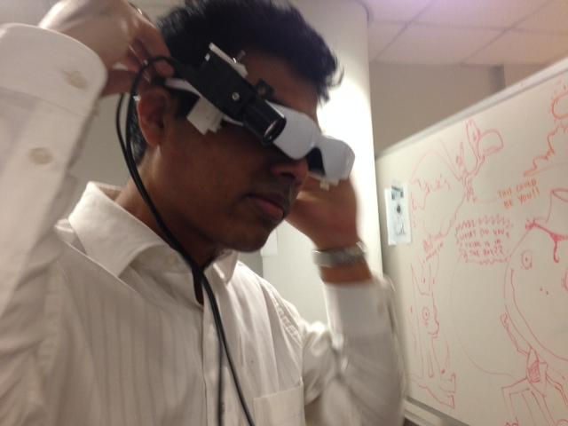 "Ph.D. Biomedical Engineering student Suman Mondal demonstrates ""cancer goggles"" at Washington University's Mallinckrodt Institute of Radiology. 1/14/15"