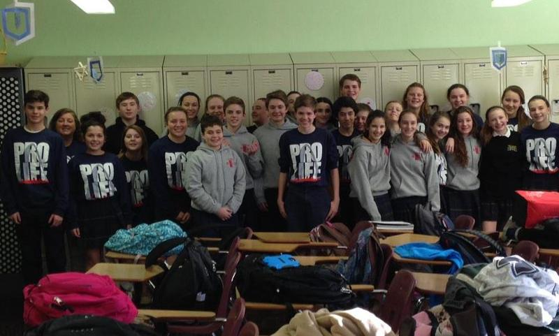 Students at Saint Raphael the Archangel School prepare to leave Wednesday for the March for Life in Washington, D.C.