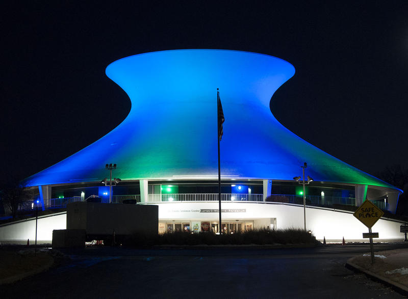 The St. Louis Science Center's planetarium was blue and green on Monday night for eating disorders awareness.