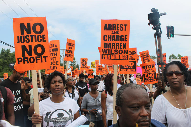 More than a thousand demonstrators gather on Canfield Drive on Aug. 30, 2014 as part of a National March on Ferguson.